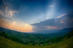 Evening, sunset on mountain hills of Simon village. Bran. Stock Photos