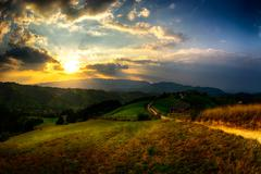 Evening, sunset on mountain hills of Simon village. Bran. - stock photo