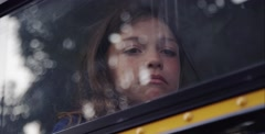 Close up of sad girl on a school bus - her parents getting divorce - stock footage
