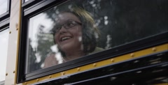 Nerdy girl looking out the window laughing - stock footage