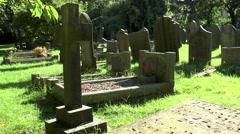 Castleton cemetery, Peak District (hard light, left-right pan). - stock footage