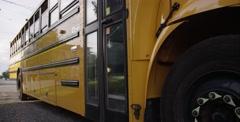 Kids Getting off of School Bus Stock Footage