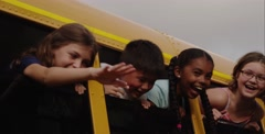 Close up of kids looking out bus window on school bus Stock Footage