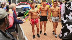 Birmingham Gay Pride - muscular guys posing - stock footage