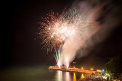 Fireworks on the beach - copy space - stock photo