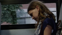 Young girl emailing on tablet on school bus Stock Footage