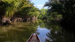 Wooden Thai Boat Cruising on River in Tropical Jungle Stock Footage