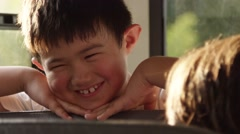 Asian Student Smiling on School Bus Stock Footage
