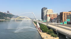Firetrucks Spray Water into the Monongahela River Stock Footage