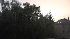 Thunderstorm with hard rain backstreet city trees Stock Footage