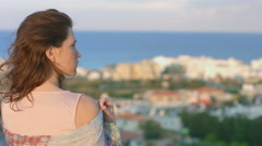 Lonely woman recalling memories, thinking about future. Amazing view of sea town Stock Footage