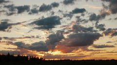 Evening sunset through the clouds - stock footage