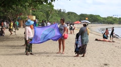 Stock Video Footage of Beach sellers on the Kuta beach. Island Bali . Indonesia