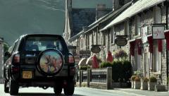 Street scene, passing car, Castleton, Peak District. - stock footage