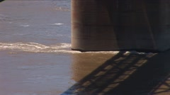 Stock Video Footage of River current and bridge piling
