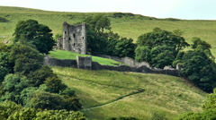 Zoom out. Peveril Castle and people on steep path, Peak District. Stock Footage