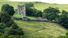 People climbing hill path to Peveril Castle, Peak District. Stock Footage