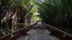 Thai Boat Floating in Jungle Stock Footage