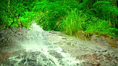 Water Tumbling and Spraying over a Natural Waterfall, with Sound Stock Footage