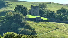Peveril Castle and people on path, Peak District. - stock footage