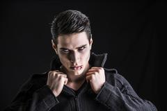 Portrait of a Young Vampire Man with Black Sweater Stock Photos