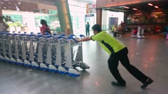 Workers Pushing Trolleys At KLIA2 Stock Footage