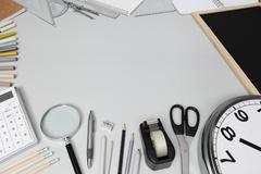 school concept, desk with stationery - stock photo