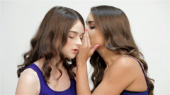Sisters whisper in their ears - stock footage