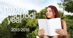School girl at the park with the book and written happy school year 2015, 201 Stock Photos