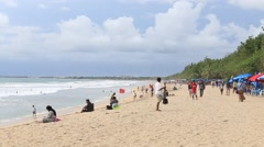 Tourist leisure are on the tropical beach with sea waves, Bali, Indonesia Stock Footage