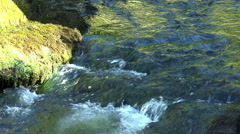 Slow motion. Flow and waterfall of narrow river. Stock Footage