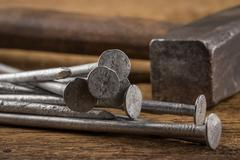 Vintage hammer with nails on wood background Stock Photos