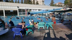Kids at Play in Public Swimming Pool in 4K Stock Footage