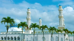 Line of Palm Trees in front of Kota Kinabalu City Mosque Stock Footage