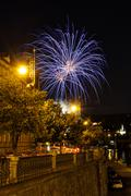 Stock Photo of Fireworks upon beautiful historical street close to riverbank