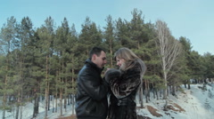 boyfriend warms hands sweetheart, frozen in the cold - stock footage