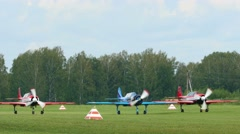 YAK-52 sport planes preparing for take-off Stock Footage