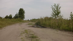 Rural dirt road in calm summer day Stock Footage