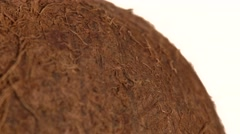 Side of coconut isolated on white, rotation Stock Footage