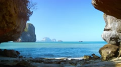 Rocky, Tropical Beach under a Clear Blue Sky, with Sound. Stock Footage