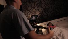 The cameraman shoots a scene from the movie with a girl in bed at night Stock Footage