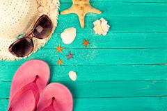 Summer accessories on blue wooden background Stock Photos
