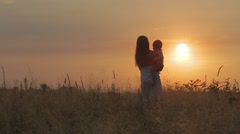 Motherhood at sunset - stock footage