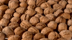 A lot of walnuts, rotation, background Stock Footage