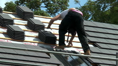 Roofer working on a barn conversion (close view). Stock Footage