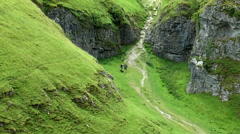 Walkers in Hope Valley beneath Peveril Castle, Peak District. Stock Footage