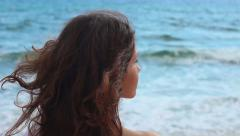 Beautiful woman with naked shoulders looking at sea, relax at resort, panorama Stock Footage