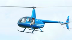 Helicopter Robinson R-44 before landing - stock footage