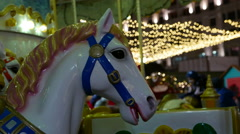 Hobbyhorse on Children's Carousel on Christmas fair. Stock Footage