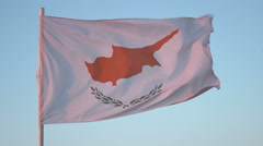 Flag of Cyprus flapping in wind, national symbol against blue sky, loopable shot Stock Footage